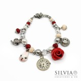 Bracciale a tema Alice con perle cristalli e charms