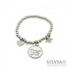 Bracciale elastico perle acciaio e frase tratta dal Piccolo Principe su sfondo bianco