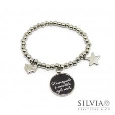 Bracciale elastico perle acciaio e frase tratta dal Piccolo Principe su sfondo nero