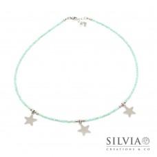 Collana girocollo con cristalli color acquamarina e tre stelle in acciaio