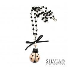 Collana catena a rosario con fiocco e coccinella rosa cipria e nera