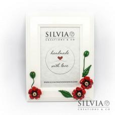 Cornice con tre fiori rossi esterno 21x16 cm ed interno 14x9 cm