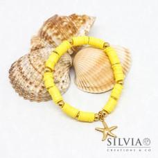 Bracciale elastico con perline heishi gialle e stella marina oro